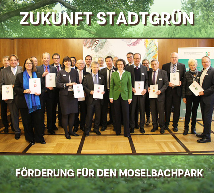Auf dem Bild: Übergabe der Bewilligungsbescheide zum Ausbau grüner Heimat. Foto: MHKBG NRW, F. Götz. Hintergrundbild: ysbrandcosijn, fotolia.com