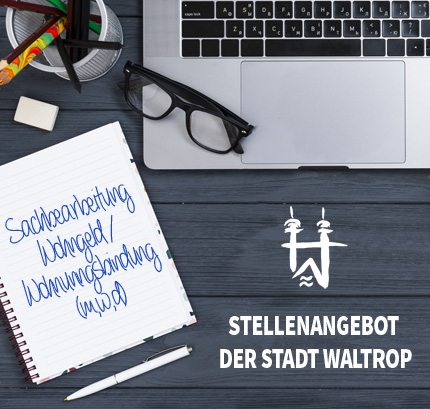 Auf dem Bild: Arbeitsplatz. Schrift im Bild: Stellenangebot der Stadt Waltrop, Sachbearbeitung Wohngeld (m/w/d).
