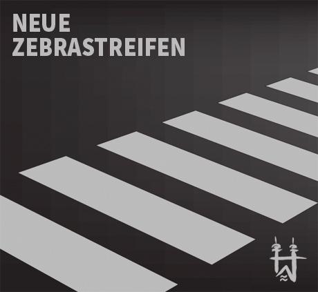 Auf dem Bild: Zebrastreifen. Text im Bild: Neue Zebrastreifen.